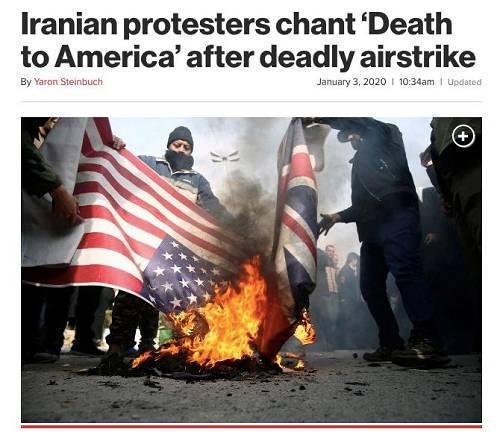 伊朗示威者当街燃烧美国国旗。《纽约邮报》网站截图