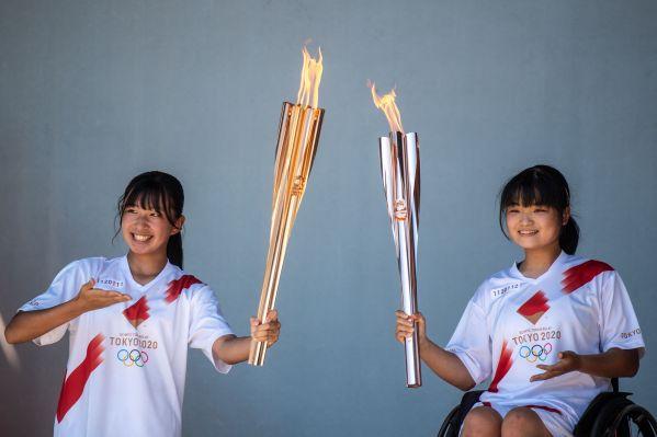 外媒披露:东京奥运曲折的火炬传递之路